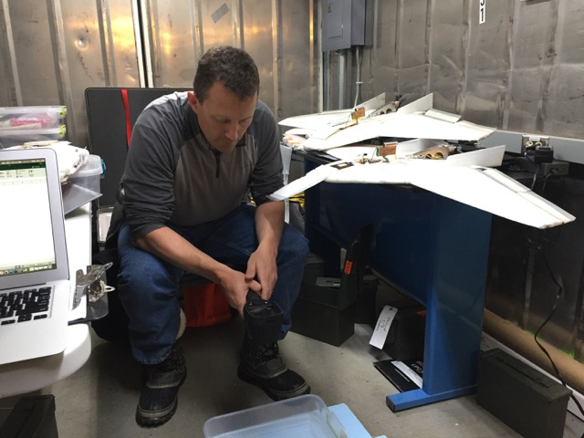 Steve checks on the temperature of the water bath we were using to provide a rough calibration for the infrared sensors carried by the planes.