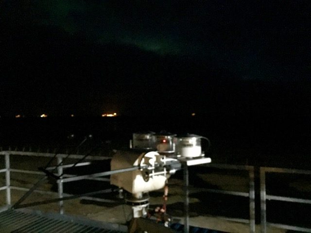 Aurora peeking through the clouds this morning over the top of the AMF-3.