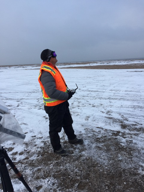 Steve pilots the DataHawk over a newly-frozen tundra landscape.
