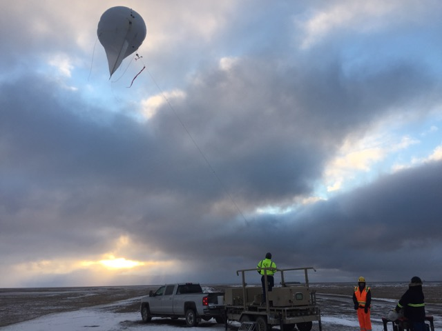 The tethered balloon crew bringing the balloon down after a successful day of flight.