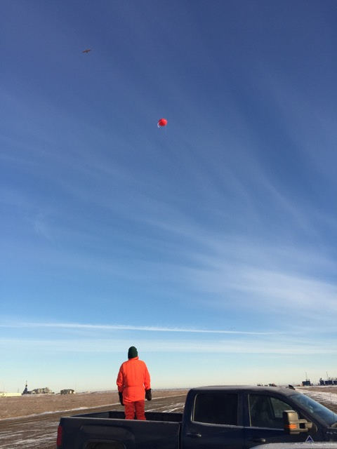 Al Bendure monitors the airspace as the DataHawk and tethered balloon do their work overhead.