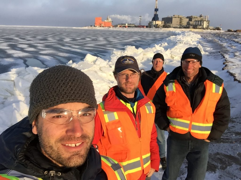 The team pauses for a photo at the ice edge.  Ice had been stacking up along the coast due to the force of the wind pushing it on shore.