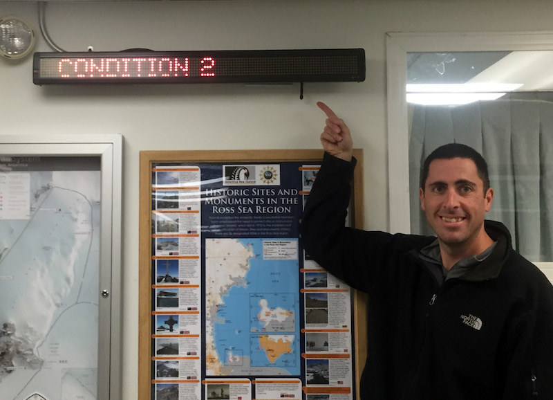 John in front of the current weather condition sign in building 155, where the galley and my dorm room are located.