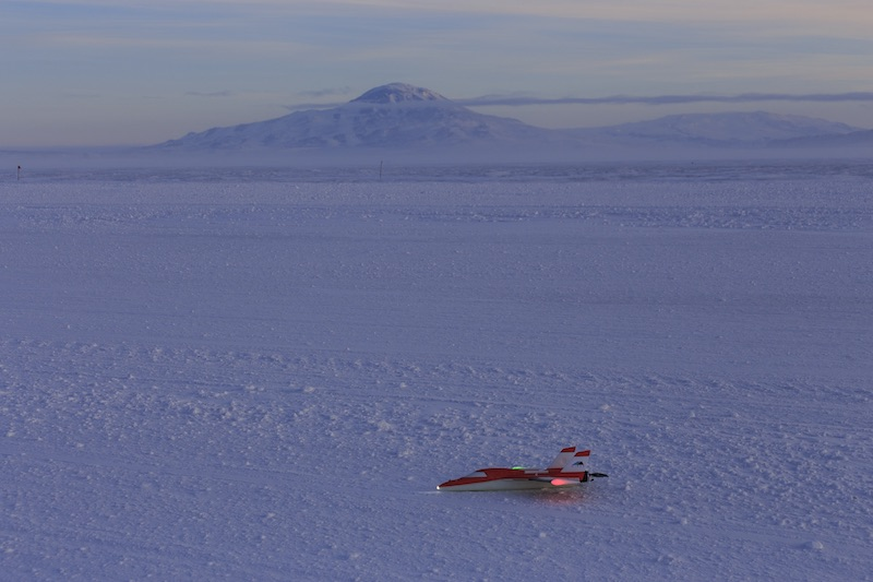 A SUMO UAV sitting on Pegasus runway after a successful flight. Mt. Discovery is in the background.