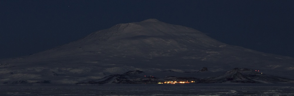 McMurdo Station and Mt. Erebus at night from the Pegasus runway.