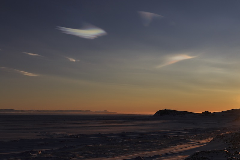 Polar stratospheric clouds over Hut Point at sunset.