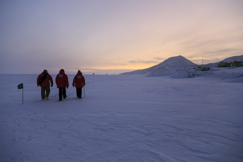 Hiking on the sea ice near New Zealand's Scott Base on Ross Island. Scott Base is the cluster of green buildings at the right edge of this photograph.