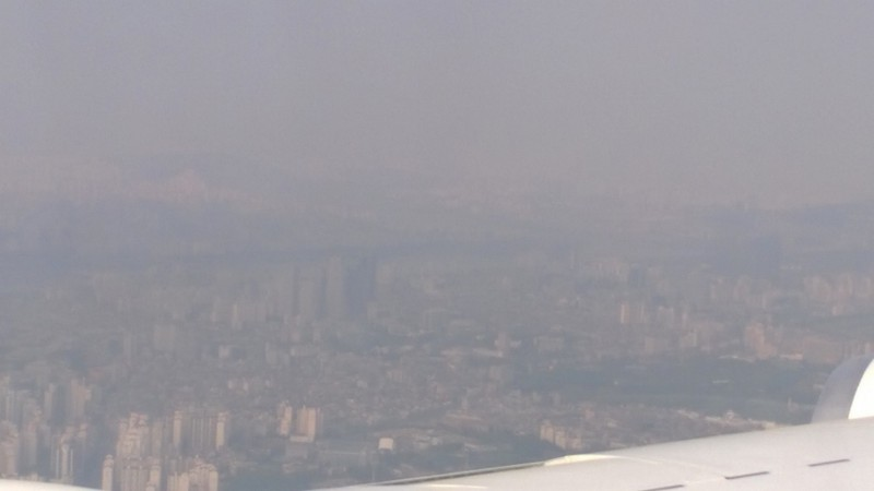 Picture of Seoul, South Korea from the NASA DC-8 during KORUS-AQ. The aerosols in the air reduce the visibility over the city.