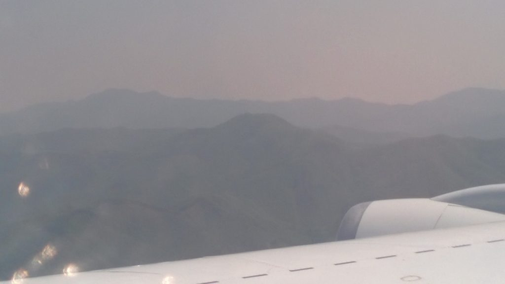 Picture of DC-8 flying near the mountains in South Korea during KORUS-AQ. Again, the aerosols in the air reduce the visibility of the mountains.