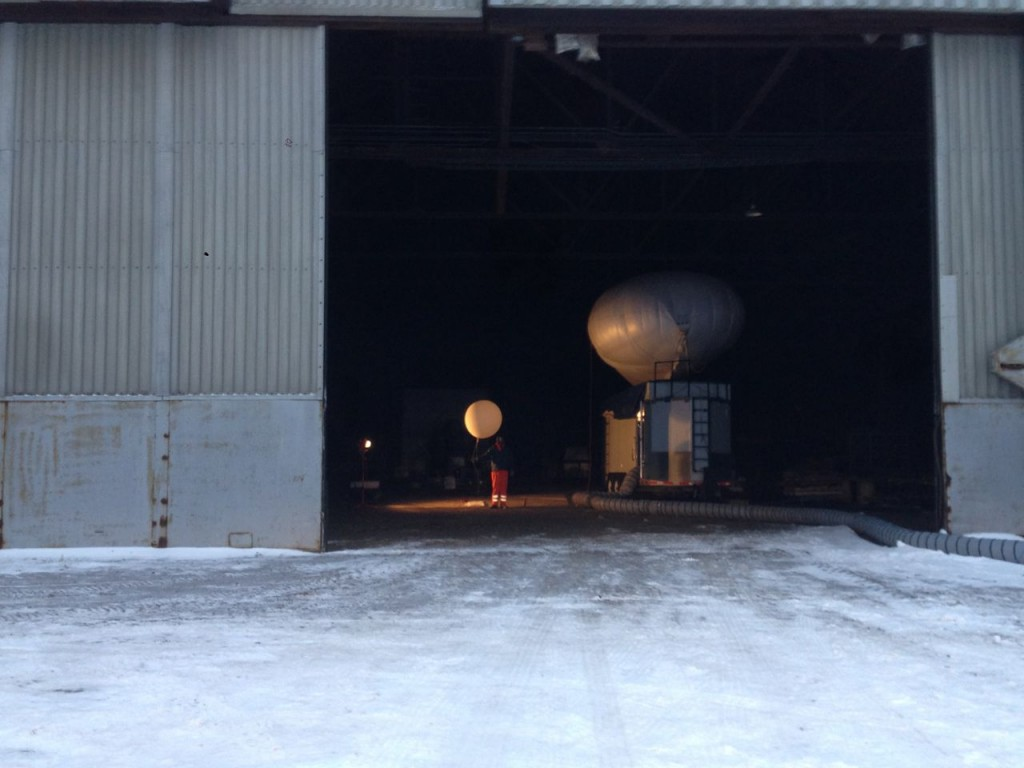 Al Bendure prepares a small balloon in the hangar.