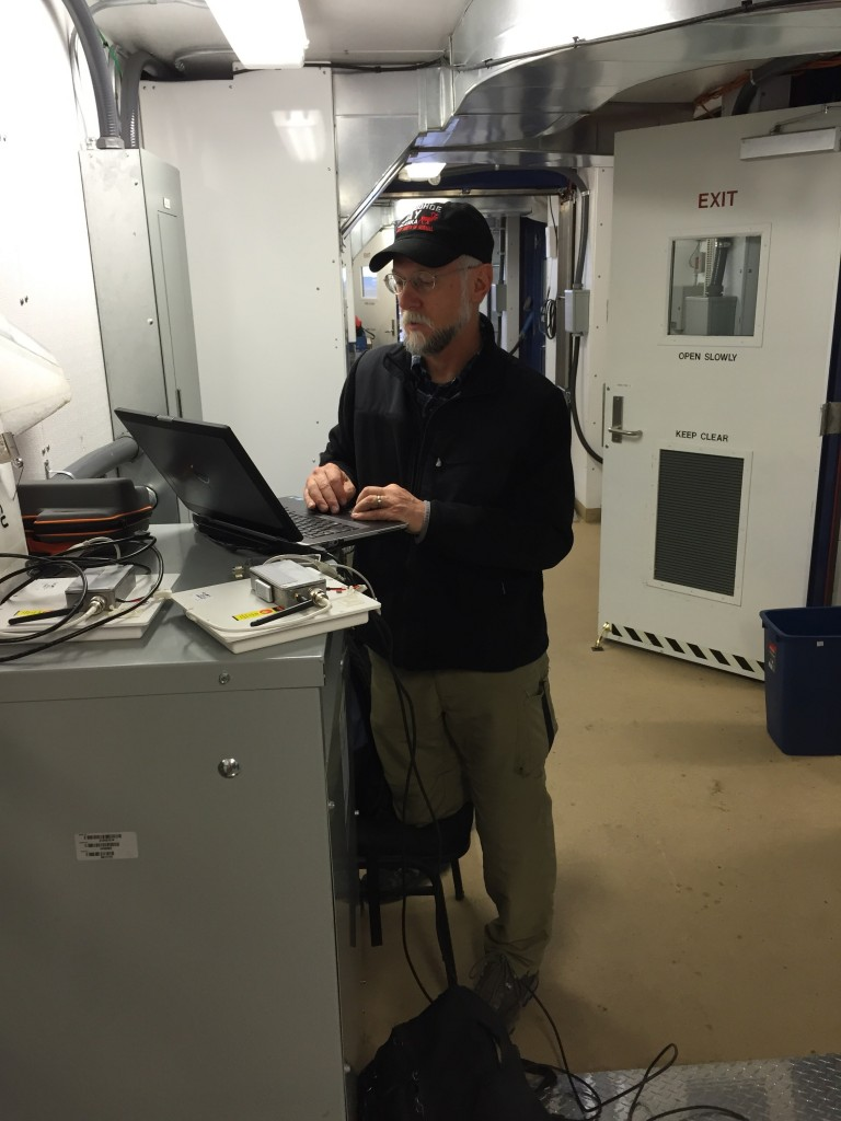 Dr. Dale Lawrence working to fine-tune the autopilot and get things set up for flight.