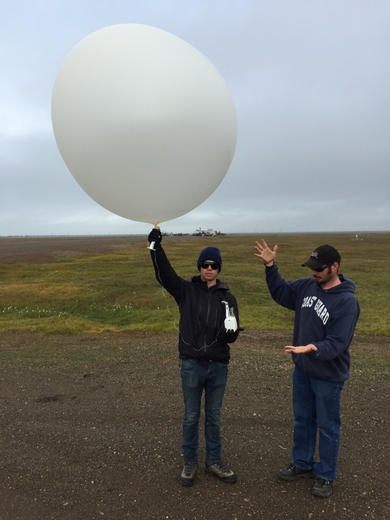 CU graduate student Nathan (left) and Oliktok operations technician Wessley (right) get ready to launch the 330 radiosonde from Oliktok Point!