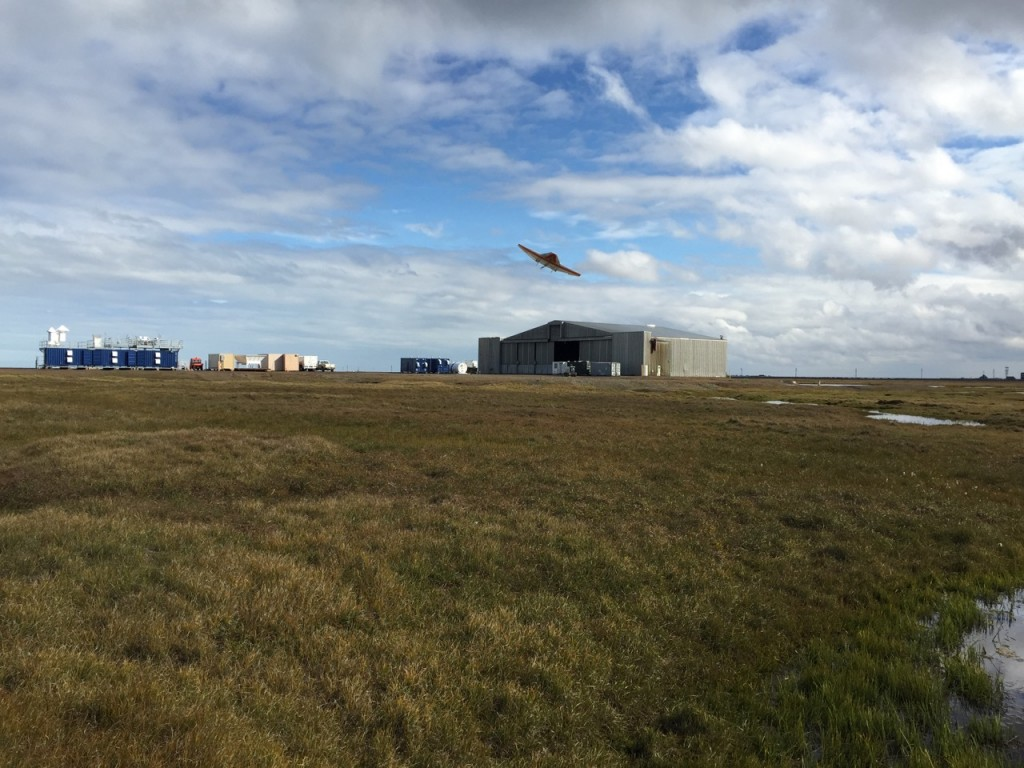 The DataHawk 2 preparing to land, with the AMF3 and hangar in the background.