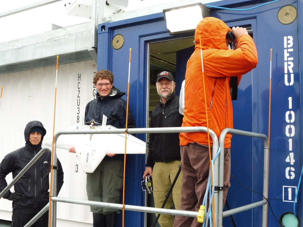 From left: Nathan, Will, Dale and Gijs, preparing for an aircraft radio range test.  Gijs is monitoring a grizzly bear that has been spotted far away from the site.