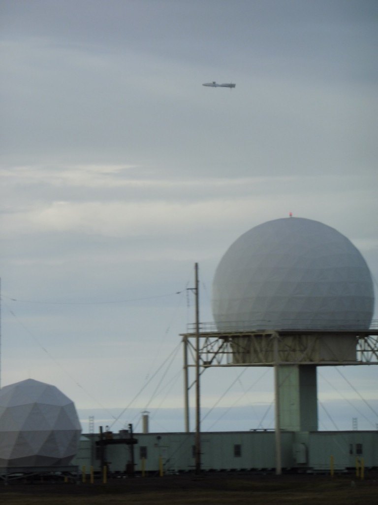 The DataHawk flying past the USAF radars, with wings as level as possible.