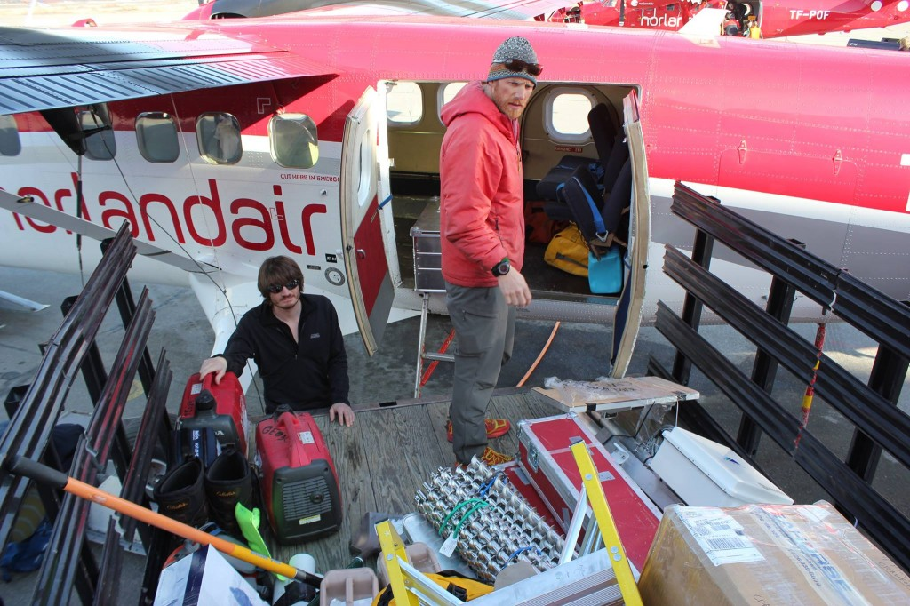Loading equipment onto the twin otter. Photo taken by Darren Hill, 2015.