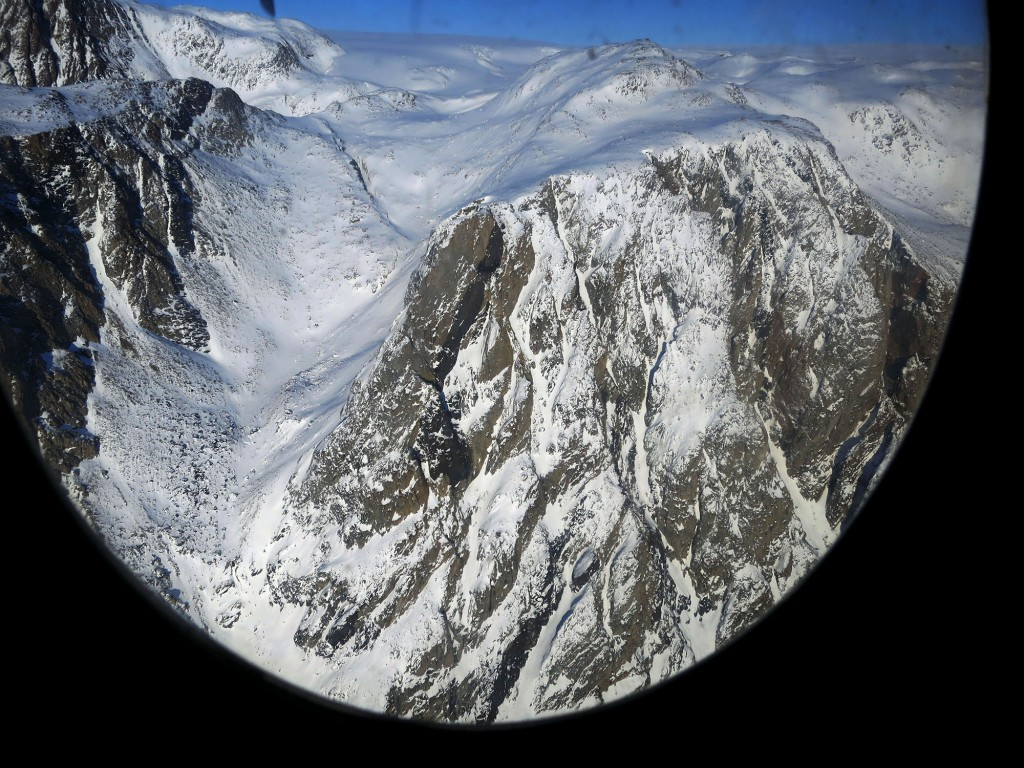View from the C-130, just north of the Sukkertoppen ice cap in Sondre Stromfjord, Greenland.