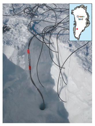 After the installation of the temperature probes in May 2012 (thin black cables) at the location of KAN_U on the Greenland ice sheet. The thick grey cables are thermistor strings drilled into the firn. The inset map shows the location of the study area.
