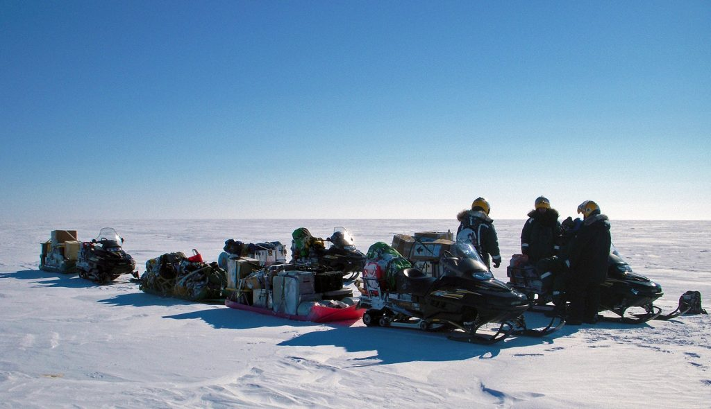 Snowmobiles pulling cargo on sleds. Photo courtesy Babis Charalampidis, ACT 2013.