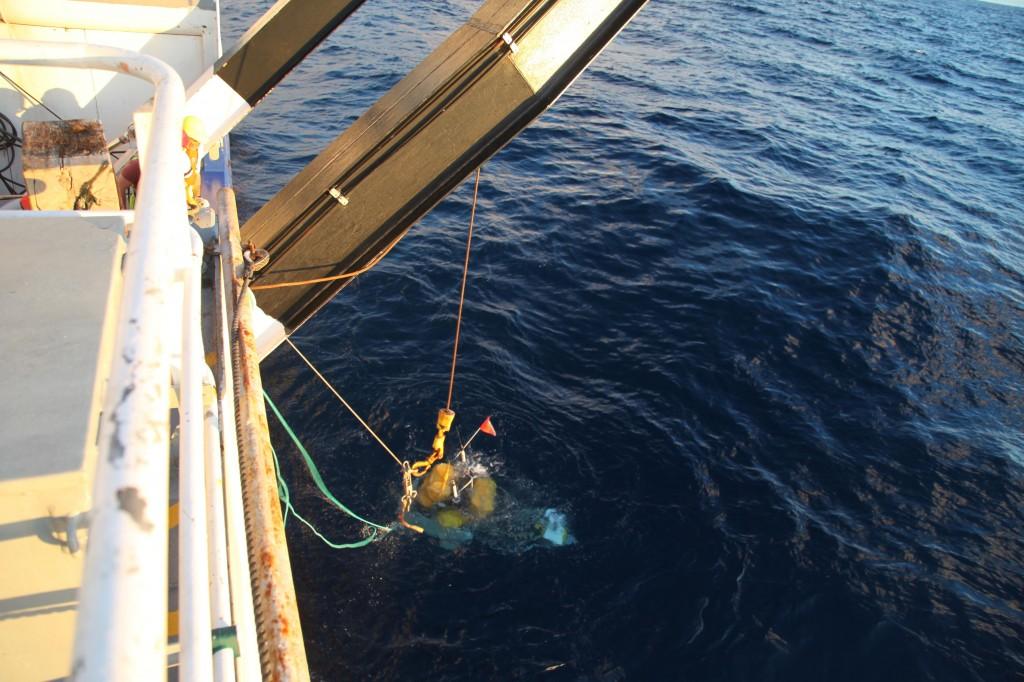 CRANE dropping seismometer into sea