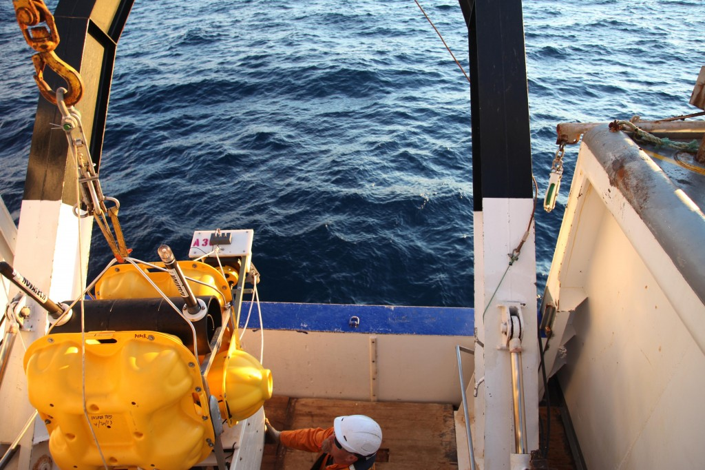 The crane lifts the seismometer + absolute pressure gauge and throws it overboard