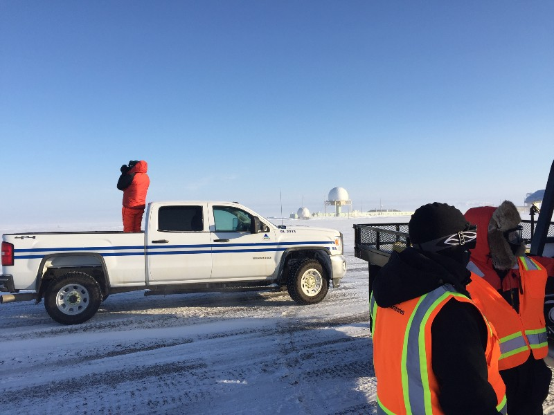 Sandia's Al Bendure (in truck bed) keeps an eye out for bear activity while the team gears up for DataHawk flights. While it looks pretty nice and sunny, the winds were whipping at around 30 mph and snow was drifting pretty substantially!