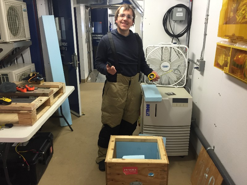 Phillip working to prepare an insulated box for operation of the POPS aerosol sampler on the roof of the AMF-3.