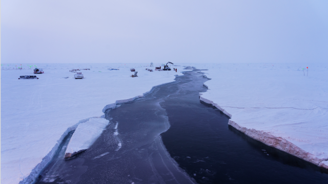 open crack in sea ice, science equipment on top